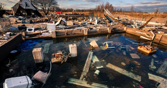 A still running water pipe floods the foundation of a home destroyed by the storm surge of superstorm Sandy in the Staten Island borough neighborhood of Oakwood in New York